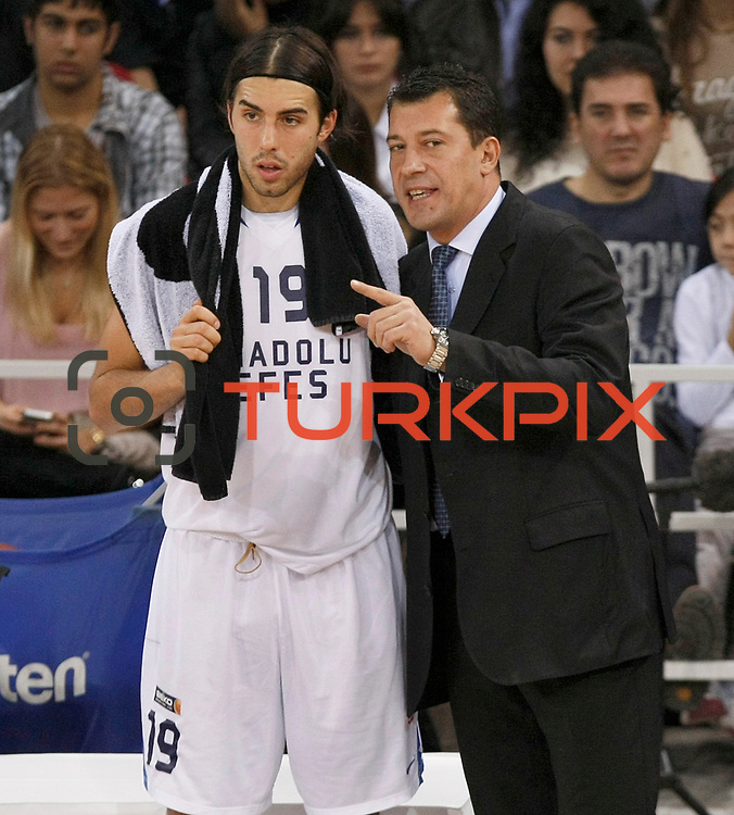 Anadolu Efes's coach Ufuk SARICA (R) and Sasha VUJACIC (L) during their Turkish Basketball League match Anadolu Efes between Aliaga Petkim at Aliaga Arena in Istanbul, Turkey, Sunday, October 23, 2011. Photo by TURKPIX