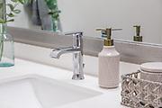 White Quartz Bathroom Counter with Chrome Faucet