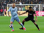 Sporting KC forward Johnny Russell (7) dribbles against LAFC defender Eddie Segura (4) during a MLS soccer match against the LAFC in Los Angeles, Sunday, March 3, 2019. LAFC defeated Sporting KC, 2-1. (Ed Ruvalcaba/Image of Sport)