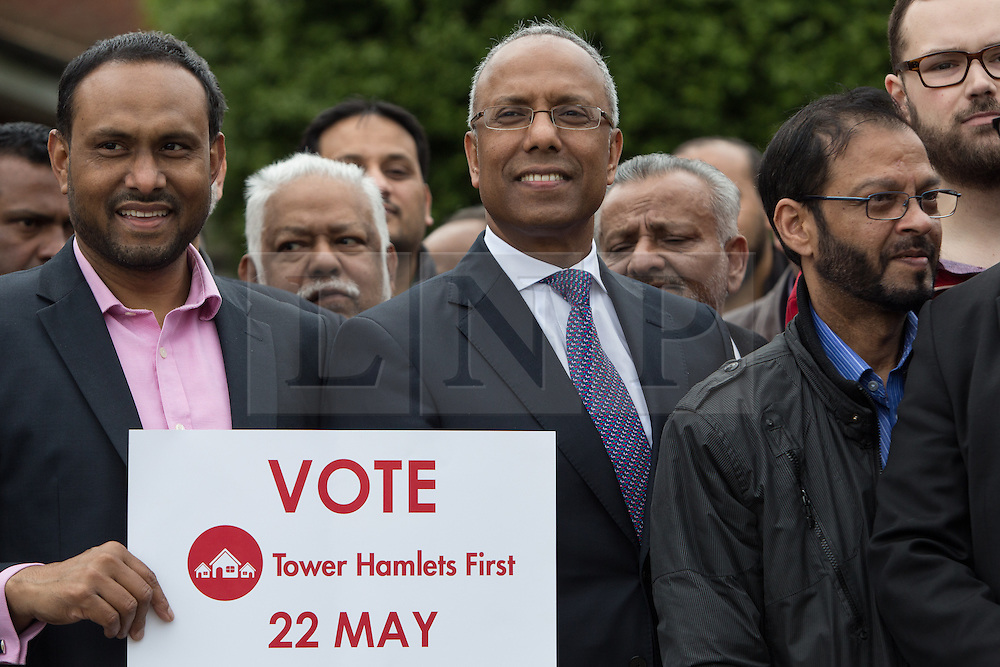 """© Licensed to London News Pictures. 05/04/2014. London, UK. Mayor of Tower Hamlets, Lutfur Rahman (centre) and supporters from the Tower Hamlets First party take part in a community walkabout in Stepney, East London on 5th April 2014 to canvas for the upcoming Mayoral election. Communities Secretary, Eric Pickles yesterday sent inspectors to start an audit of Tower Hamlets council and the Rahman administration following allegations of fraud and financial mismanagement, also reported by BBC's Panorama programme this week. Mayor Lutfur Rahman denies all allegations, which he calls """"Panorama lies"""". Photo credit : Vickie Flores/LNP"""