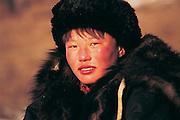 Darkhad boy in winter<br /> at Lake Hovsgol<br /> Mongolia