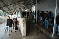1 March 2020, Bethlehem: People enter into Checkpoint 300, where tens of thousands of Palestinians, most of them working in construction and maintenance, cross from Bethlehem to Jerusalem in the mornings.