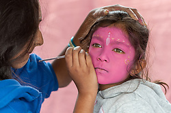 © Licensed to London News Pictures. 05/09/2015. Watford, UK. Meena, aged 7, has face-paint applied with gopi dots during her visit to the biggest Janmashtami festival outside of India at the Bhaktivedanta Manor Hare Krishna Temple in Watford, Hertfordshire.  The event celebrates the birth of Lord Krishna and the festival  includes music, dance, food, dramas and more. Photo credit : Stephen Chung/LNP