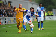 Newport Captain David Pipe challenges John Joe O'Toole of Bristol Rovers to the ball. Skybet League two match, Newport county v Bristol Rovers at Rodney Parade in Newport, South Wales on Saturday 17th August 2013.  pic by Phil Rees ,Andrew Orchard sports photography,