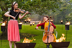 EMBARGOED UNTIL 10AM, WEDNESDAY 2 JUNE<br /> Edinburgh International Festival, Edinburgh, Scotland, United Kingdom: <br /> Pictured: Jenna Reid on fiddle and Su-a Lee, cellist, in the Royal Botanic Garden.<br /> Edinburgh International Festival pioneers the return of live performance in Scotland from 7–29 August with a diverse programme of UK and international artists. This year's programme features over 170 classical and contemporary music, theatre, opera, dance and spoken word performances, including 15 new commissions and premieres. Audience safety is key with measures including outdoor venues, social distancing, shorter performances without intervals, audience members in bubbles and, for the first time, online access to free performances.   <br /> Sally Anderson | EdinburghElitemedia.co.uk