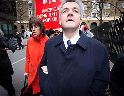 © London News Pictures. 11/03/2013 . London, UK.  Former British cabinet minister CHRIS HUHNE arriving at Southwark Crown Court with his partner CARINA TRIMINGHAM on March 11, 2013 where CHRIS HUHNE is due to be sentenced for perverting the course of justice. CHRIS HUHNE admitted asking his wife, Vicky Pryce, to accept penalty points on his behalf following a driving offence in 2003. Photo credit : Ben Cawthra/LNP