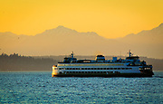 Washington state ferry in Elliott Bay with the Olympic mountains in the distance