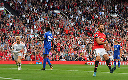 Manchester United's Juan Mata (right) reacts after having his shot saved by Leicester City goalkeeper Kasper Schmeichel (left) from close range