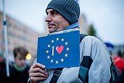 "Prostestor with a pro EU sign in front of  ""Top Hotel"" in Prague's quater Chodov. They are protesting for European values and against the conference of the European anti-migrant parties ""Europe of Nations and Freedom"" (ENF). Attending were Marie Le Pen from France, Geert Wilders from Holland and Tomio Okamura of the Freedom and Direct Democracy (SPD) movement from Czech Republic which was hosting the meeting."