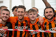 George Honeyman of Hull City, Keane Lewis-Potter of Hull City gather outside the KCOM stadium to celebrate infront of fans winning the league 1 title during the EFL Sky Bet League 1 match between Hull City and Wigan Athletic at the KCOM Stadium, Kingston upon Hull, England on 1 May 2021.