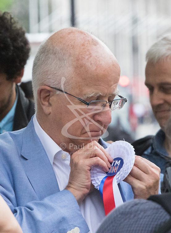 """Westminster, London, June 23rd 2016. Spotted outside Parliament is disgraced former Labour MP Denis MacShane who resigned in 2012 following his conviction for false accounting, fixes an """"I'm IN"""" rosette to his jacket."""