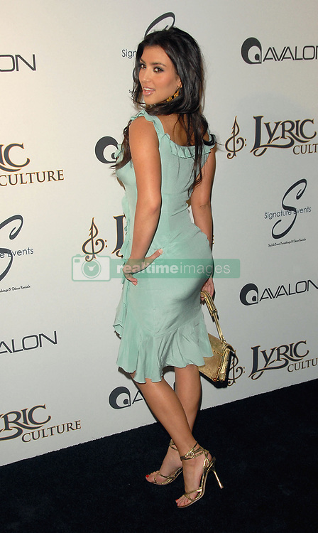 Kim Kardashian attends The Lyric Culture Launch Party held at Avalon in Hollywood, Los Angeles, CA, USA on May 10, 2007. Photo by Debbie VanStory/ABACAPRESS.COM  Kardashian Kim Kardashian Kimberly Verts Vertes Vert Verte Couleur verte Green Green Color Green Colour Fesses Fesse Butt Robes Robe Dress Long Dress Robes longues Robe longue Maxi Dress Seule Seul Seuls Seules Alone Soiree Party Tenue Glamour Tenue de soiree Formal DressEvening Dress Los Angeles USA United States of America Vereinigte Staaten von Amerika Etats-Unis Etats Unis De dos Rear view En pied Full length    122183_05 Los Angeles