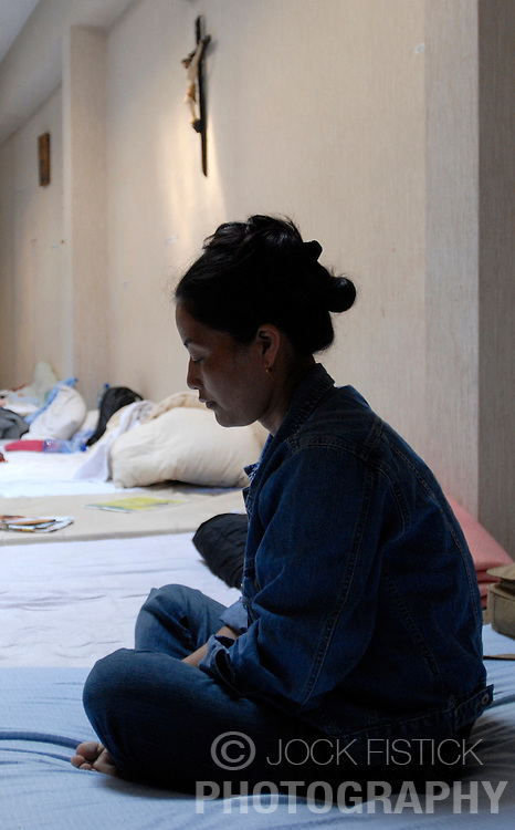 LEUVEN, BELGIUM - AUGUST-17-2006 - Refugees from Nepal, Bhutan, Afghanistan, and Iraq who have been residing at St. Michiel Catholic Church in Leuven, announced that they have ended their hunger strike in response to a plea from the Belgian government. (PHOTO © JOCK FISTICK)