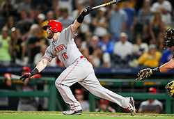 Jun 15, 2018; Pittsburgh, PA, USA; Cincinnati Reds catcher Tucker Barnhart (16) hits a single during the ninth inning against the Pittsburgh Pirates at PNC Park. Mandatory Credit: Ben Queen-USA TODAY Sports