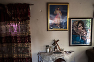 Religious paintings hang on the walls inside the home of deported U.S. Army veteran Jose Marquez in Santo Domingo, Dominican Republic, Thursday, July 5, 2018.