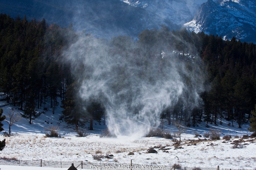 A whirlwind blowing across the snow covered Beaver Meadows in Rocky Mountain National Park, Colorado.