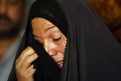 Beheyen Ibrahim Jar, mourns after learning that her husband died at the hands of a U.S. soldier,  Baghdad, Iraq, Sept. 27, 2003.