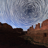 Star trails with Park Avenue in the forground Arches National Park near Moab Utah.
