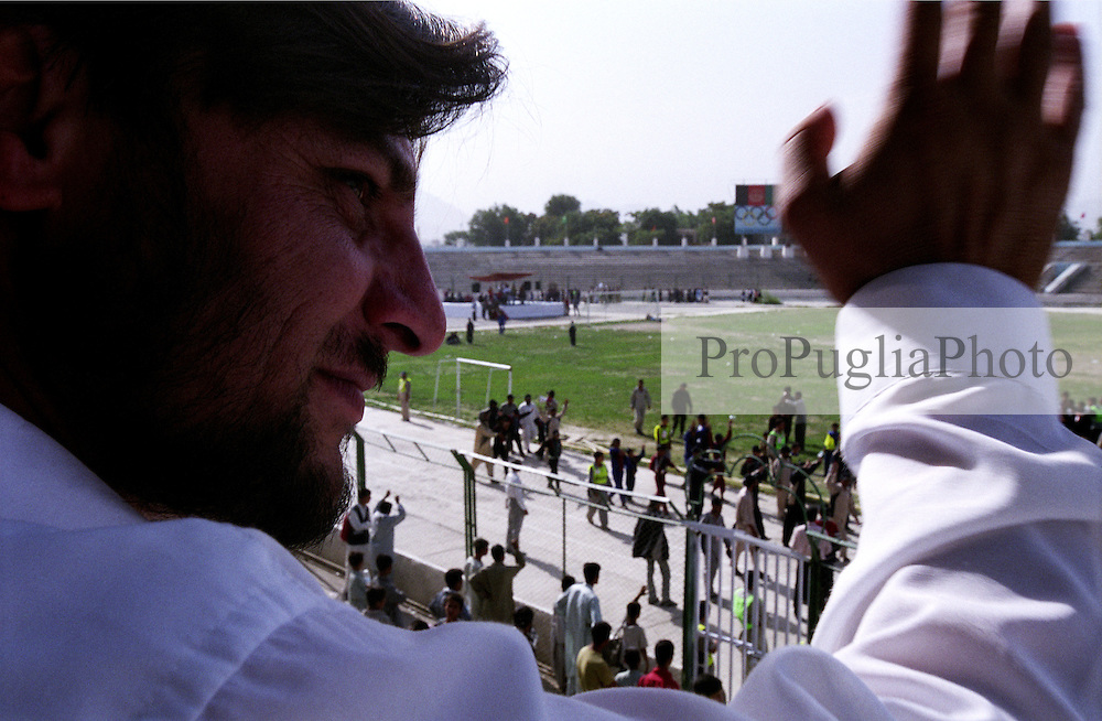 Mr Nasrullah Izat, national Director of SOA, waves to the Athletes during the closing of the Olympics games at Ghazi Stadium