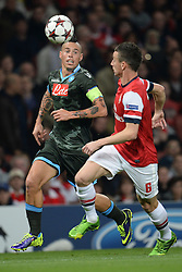 LONDON, ENGLAND - Oct 01: Napoli's midfielder Marek Hamsík from Slovakia and Arsenal's defender Laurent Koscielny from France  compete for the ball during the UEFA Champions League match between Arsenal from England and Napoli from Italy played at The Emirates Stadium, on October 01, 2013 in London, England. (Photo by Mitchell Gunn/ESPA)