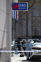 © Licensed to London News Pictures. 16/03/2020. London, UK. A Forensic Officer works near a branch of Metro Bank on the Kings Road in Chelsea after a vehicle was reportedly driven into the bank . Photo credit: George Cracknell Wright/LNP