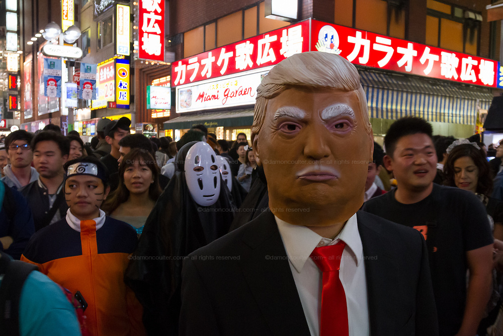 A man wears a Donald Trump costume during the Halloween celebrations Shibuya, Tokyo, Japan. Saturday October 27th 2018. The celebrations marking this event have grown in popularity in Japan recently. Enjoyed mostly by young adults who like to dress up, drink , dance and misbehave in parts of Tokyo like Shibuya and Roppongi. There has been a push back from Japanese society and the police to try to limit the bad behaviour.