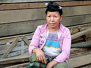 Portrait of a Lahu Soung/Khoui ethnic minority woman wearing a comb in her hair at Ban Phon village, Luang Namtha province, Lao PDR. One of the most ethnically diverse countries in Southeast Asia, Laos has 49 officially recognised ethnic groups although there are many more self-identified and sub groups. These groups are distinguished by their own customs, beliefs and rituals.