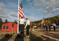 Fire Chief Steve Carrier, Police Chief Anthony Bean Burpee and DPW Director Sheldon Morgan raise the flag during the flagpole dedication Tuesday afternoon at the Gilford Outing Club/Warming Hut in honor of first responders.   (Karen Bobotas/for the Laconia Daily Sun)
