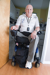 Male wheelchair user at home,