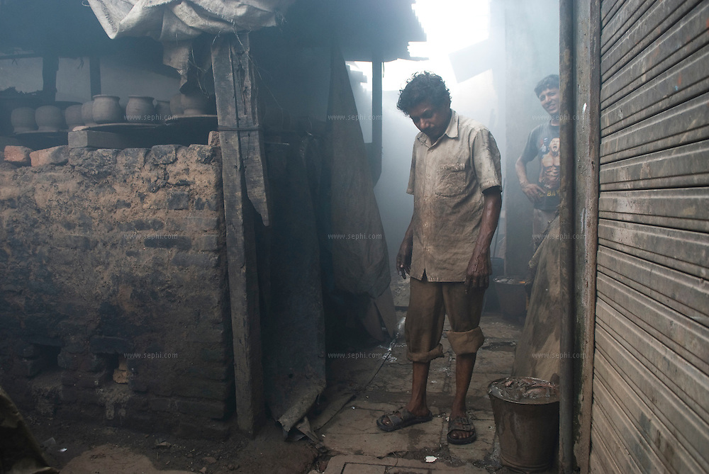 A potter waits to fire his next batch in the kiln.