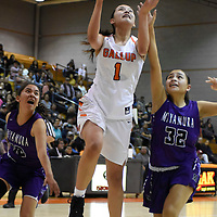 Photo: Jeffery Jones - Feb 27, 2019<br /> Gallup Lady Bengal Ashley Antone (1) gets past Miyamura Lady Patriot Odessa Begay (12) and Fetisha Johnson (32) to shoot a basket during Wednesday's district play-off game at Gallup High School. The Lady Bengals won 50-39.