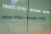 As it is reported that a further 428 people have died with Covid-19 in the UK, the total number of deaths in hospitals and the wider community to 33,614, the wider implications of social distancing in the workplace after lockdown is being widely discussed with the concept of 'hot desking' being a thing of the past. A closed Hot Desking office space in Noel Street, Soho advertises in its window, on 14th May 2020, in London, England.