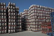 Beer barrels piled high on pallets Adnams distribution centre, Reydon, near Southwold, Suffolk, England