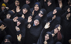 Oct. 4, 2015 Tehran, Iran - Iranian women mourn during a funeral ceremony in downtown Tehran, Iran. Thousands of Iranians held ceremonies on Sunday to mourn their pilgrims who died in the latest Hajj stampede in Saudi Arabia on Sept. 24. The ceremonies were held in the capital, Tehran, and Iran's other cities to see off the dead bodies of 104 Iranian pilgrims that were transferred to Tehran on Saturday. (Credit Image: © Ahmad Halabisaz/Xinhua via ZUMA Wire)