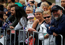 People wait for the Duke and Duchess of Sussex to arrive at the Royal Botanic Gardens in Melbourne on the third day of the royal couple's visit to Australia.