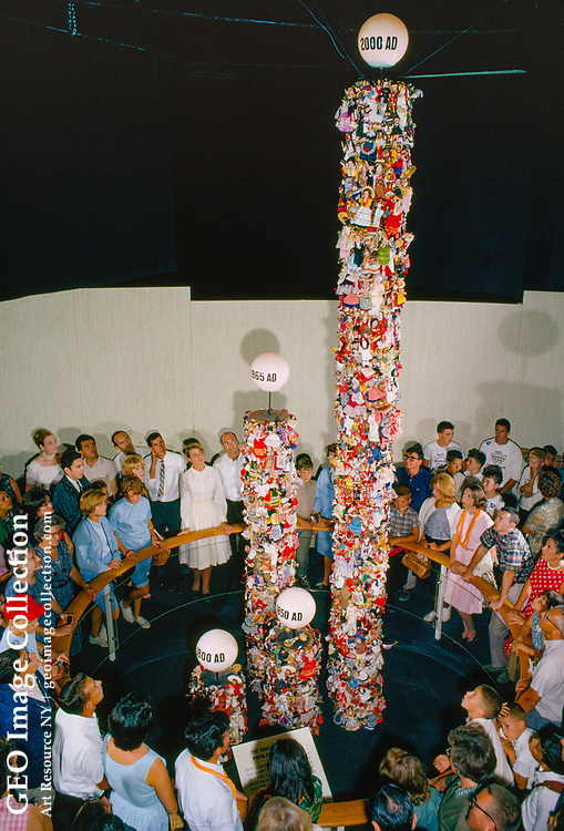 Doll totem poles at the United States Pavilion show population growth.
