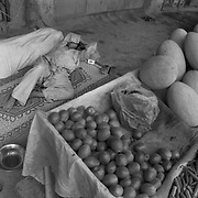 Shop keepers in Kandahar City nap on a rug outside their vegetable stand containing melons, tomatoes, onions and okra in a bazaar in Kandahar City, Afghanistan. MOst of this produce is grown in the surrounding farming districts around Kandahar City. (Credit Image: © Louie Palu/ZUMA Press/The Alexia Foundation).....
