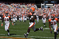 COPYRIGHT DAVID RICHARD.Cleveland receiver Braylon Edwards pulls in a 34-yard touchdown pass from Derek Anderson in the third quarter. Defending for Cincinnati are Dexter Jackson, left, and Leon Hall..The Cleveland Browns defeated visiting Cincinnati 51-45, Sunday, September 16, 2007..