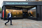 A man walks past  the Amazon Black Friday pop-up shop in Shoreditch, east Lonon on November 23, 2018