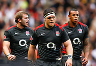 Tom Croft (L), Andrew Sheridan (C) and Courtney Lawes (R) walk off the pitch at half time during the Investec series international between England and Australia at Twickenham, London, on Saturday 13th November 2010. (Photo by Andrew Tobin/SLIK images)