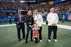 The Hollis family receives the Children's Healthcare of Atlanta T4C Trophy during the 2018 Chick-fil-A Peach Bowl between the Florida Gators and the Michigan Wolverines on Saturday, December 29, 2018, in Atlanta. (Paul Abell via Abell Images for the Chick-fil-A Peach Bowl/Dodd Trophy)