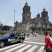 MEXICO CITY, MEXICO --A view of the front of the Metropolitan Cathedral from Madero Street which runs along the northern side of the Zocalo in the historic quarter of Mexico City. Built in stages from 1573 to 1813, the Mexico City Metropolitan Cathedral is the largest Roman Catholic cathedral in the Americas. It sits in the heart of the historic quarter of Mexico City along one side of the the Zocalo.