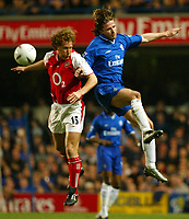 Photo: Scott Heavey<br />Chelsea v Arsenal. FA Cup quater final replay.<br />25/03/03<br />Arsenals Ray Parlour (left) and Emmanuel Petit compete in the air during this London derby.