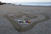 Local residents of the Kent seaside town of Folkestone had gathered around a heart with the figure 39 in it on Sunny Sands Beach on 27th October 2019 in Folkestone, Kent, UK. The vigil was organised by locals to remember the 39 people discovered in Essex from Vietnam who perished in the back of a truck while being trafficked into the UK inside a refrigerated container.