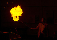 Middletown, New York  - Professor Timothy MacMahon lights a balloon filled with hydrogen during Kids Chemistry Night at SUNY Orange on Oct. 24, 2014. The program was sponsored by the college  Chemistry Club and the American Chemical Society.