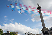 On the day French President Emmanuel Macron visits London to celebrate the 80th anniversary of Charles de Gaulles famous wartime broadcast calling French citizens to arms against Nazi occupiers, the British Royal Air Forces Red Arrows aerobatic team lead their French aviation counterparts, La Patrouille de France, over Nelsons column in Trafalgar Square, on 18th June 2020, in London, England.