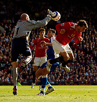 Photo: Jed Wee.<br />Manchester United v Blackburn Rovers. The Barclays Premiership. 24/09/2005.<br /><br />Manchester United's Ruud van Nistelrooy (R) goes tumbling in the box in a clash.