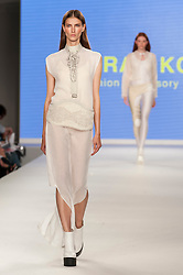 © Licensed to London News Pictures. 07/06/2016. London, UK. A model presents a look by Farah Kone from Ravensbourne.  Graduate Fashion Week, day three, takes place at the Old Truman Brewery in East London.  The event showcases the work of over 1,000 of the very best graduates from over 40 universities around the world through 22 catwalk shows and more.  Photo credit : Stephen Chung/LNP