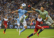 Sporting Kansas City midfielder Graham Zusi (8) attempts a shot on goal during the second half against FC Dallas goalkeeper Jesse Gonzalez (1) at Children's Mercy Park.
