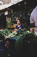 Puerto Princesa, Palawan, Philippines - Joylyn Ticar Felicidario, 22, sells produce at the main market in Puerto Princesa.